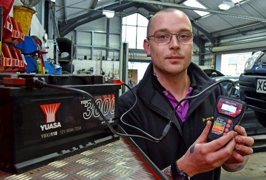 Jason Burlton, Workshop Manager at Phillips Tyres in Shepton Mallet tests a battery with Yuasa's Always Check The Battery Tester