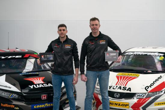 Matt Neal & Dan Cammish holding Yuasa batteries